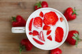 Ceramic Cup of Milk,Red Fresh Strawberries on the Wooden Background.Breakfast Organic Healthy Tasty Food.Cooking Vitamins Royalty Free Stock Photo