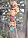 Ceramic dolls boys and girls are climbing tree in the garden they are happiness easy happy life in home Royalty Free Stock Image