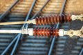 Ceramic insulators high voltage used on railway shallow dof Royalty Free Stock Images