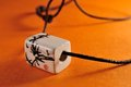 Ceramic pendant with painting leather string Royalty Free Stock Photography