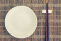 Ceramic plate and wood chopsticks Royalty Free Stock Photo