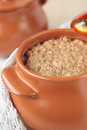Ceramic pot with barley porridge Royalty Free Stock Photo
