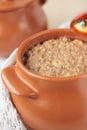 Ceramic pot with barley porridge Royalty Free Stock Photo