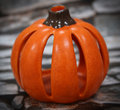Ceramic pumpkin with a slate brick background bright orange halloween decoration and candle holder Stock Photo