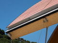 Ceramic roof with wooden parts and sky horizontal Royalty Free Stock Photography