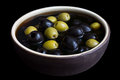 Ceramic rustic bowl of black and green olives. Royalty Free Stock Photo