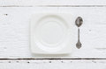Ceramic square dessert plate and tea spoons top view of white vintage teaspoon putting on old wooden table Stock Photos