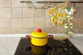 Ceramic stove yellow pot at in kitchen Royalty Free Stock Images