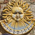 Ceramic sundial meridian on stone wall Royalty Free Stock Images