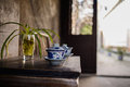 Ceramic teacups on table at ancient Chinese dwelling house Royalty Free Stock Photo