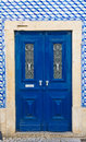 Ceramic tiles wooden door in the wall decorated with portuguese Stock Photos