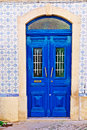 Ceramic tiles wooden door in the wall decorated with portuguese Royalty Free Stock Image