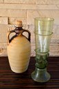 Ceramich pitcher and green wine glass Royalty Free Stock Photo