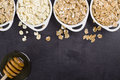 The cereals spoon with seeds of almonds flakes sesame pumpkin and cranberry flakes Royalty Free Stock Photography