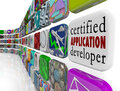 Certified application developer apps programming software develo on an app tile in a wall of and programs to tout your skills as a Royalty Free Stock Image