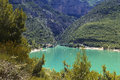 The cerulean blue lac sainte croix du verdon and mountains and gorge of gorges france also known as grand Royalty Free Stock Image