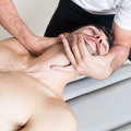 Cervical manipulation of an elder patient Royalty Free Stock Photos