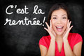 Cest la rentree scolaire french back to school student screaming happy written in on blackboard by woman teacher smiling Royalty Free Stock Photography