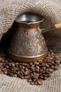 Cezve with freshly roasted coffee beans Royalty Free Stock Photo