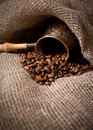 Cezve with freshly roasted coffee beans Stock Photo
