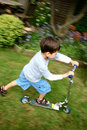 Chłopak scooter young Zdjęcia Stock