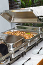 Chafing dish heater with fish kebab Stock Photo