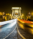 Chain bridge at night budapest hungary the szechenyi is a suspension that spans the river danube between buda and pest the western Royalty Free Stock Image