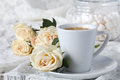 Chain drinking hot tea on a wooden floor with beautiful roses. Royalty Free Stock Photo
