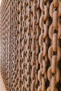Chain heap wall. Abstract metallic brown chains background. Metallic texture pattern Royalty Free Stock Photo