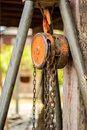 Chain hoist with a large wooden pole the Stock Images