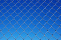 Chain Link Fence Against a Gradient Sky Royalty Free Stock Images