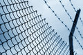 Chain link fence with blue sky Royalty Free Stock Image