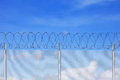 Chain link fence with blue sky Royalty Free Stock Photos