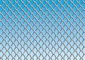 Chain link fence with blue sky background Royalty Free Stock Photo