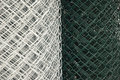 Chain link fence coils galvanized and green pvc coated Royalty Free Stock Photography