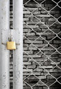 Chain link fence and metal door with lock Royalty Free Stock Photography