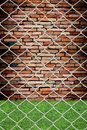 Chain link fence see grunge wall Royalty Free Stock Photo