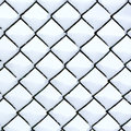 Chain link fence with snow covered fresh Royalty Free Stock Image
