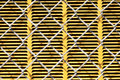 Chain link texture a fence in front of a yellow metal panel for background or Stock Images