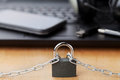 Chain with lock in front of the laptop and smartphone, gadget and digital devices detox concept