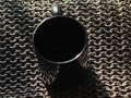 Metal rings woven together background metal mug stands Royalty Free Stock Photo