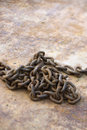 Chain on rusty metal. Stock Images