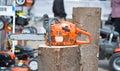 Chain saw on log Stock Photo