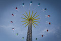 Chain swing colorful carts on a giant high up in the sky Stock Photography
