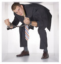 Chained businessman in the cube Stock Photos