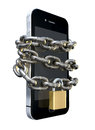 Chained and padlocked smartphone a wrapped in a metal chain secured with a brass padlock denoting internet seurity on an isolated Royalty Free Stock Photo