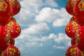 Chainese lanterns chainese new year chinese decoration against cloudy blue sky Royalty Free Stock Photos