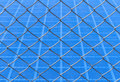 Chainlink fence against blue background Royalty Free Stock Images