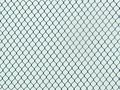 Chainlink Fence Industrial Texture, creates an optical illusion Royalty Free Stock Photo