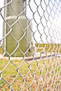 Chainlink fencing on an industrial site Royalty Free Stock Photo
